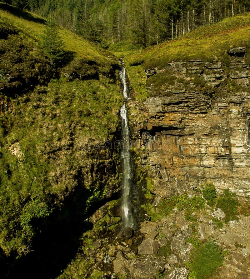 Drone photograph of a hidden waterfall in south wales stock photo