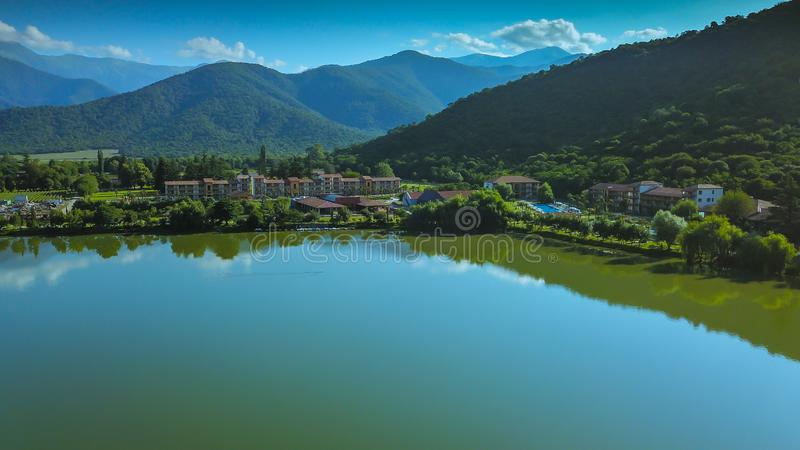 Lapota lake with green mountains reflections located in Georgia country. stock images