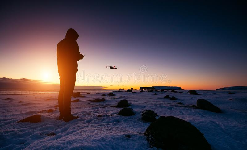 Drone pilot with unmanned aircraft in beautiful sunset ligt stock images