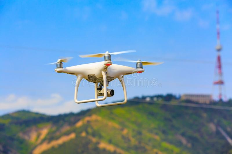 Drone quadcopter with digital camera over city stock image