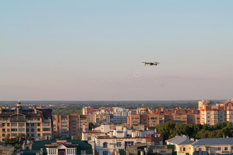 Drone quadcopter with digital camera above. Concept royalty free stock photo