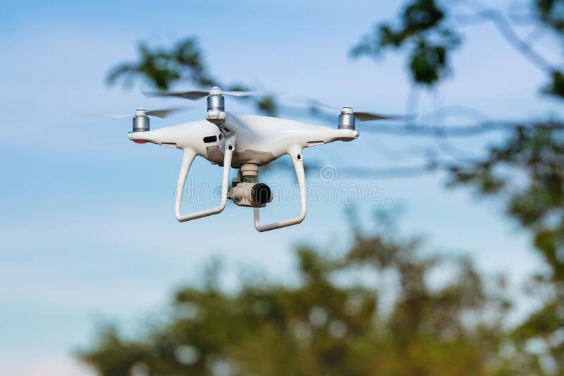 Drone quadcopter DJI Phantom flight in summer blue sky and photographs royalty free stock photography