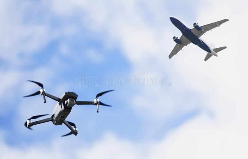 Drone quadcopter flying and airplane aircraft in sky in danger of crash or collision royalty free stock images