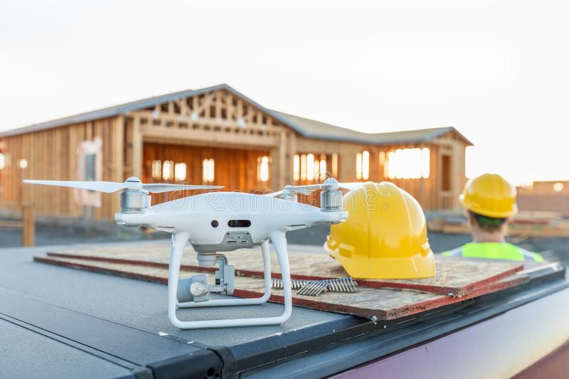 Drone Quadcopter Next to Hard Hat Helmet At Construction Site stock images