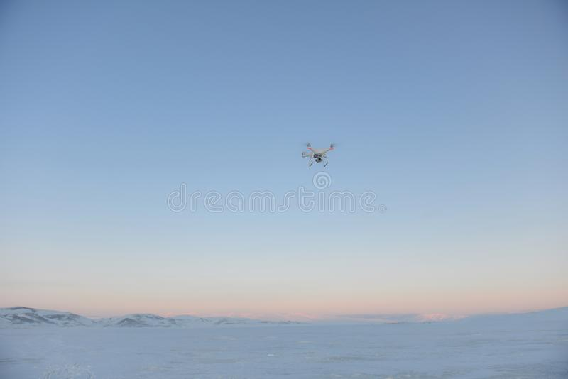 Drone quadrocopter hovering in the sky royalty free stock photography