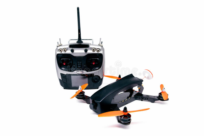 Drone racing FPV quadrotors black color and radio control. On white background stock images