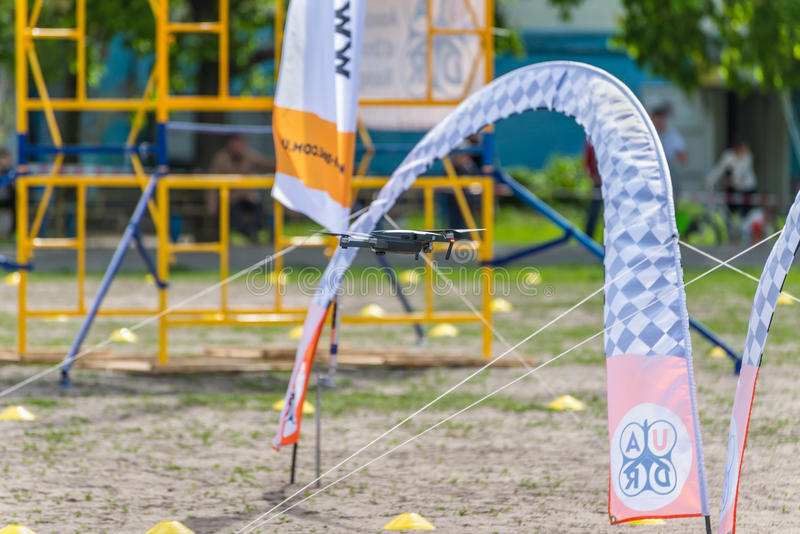 Drone Racing. Kyiv, Ukraine - April 29, 2017: Drone flies through the Racing gates during the first Drone Festival in Kyiv, Ukraine stock photography