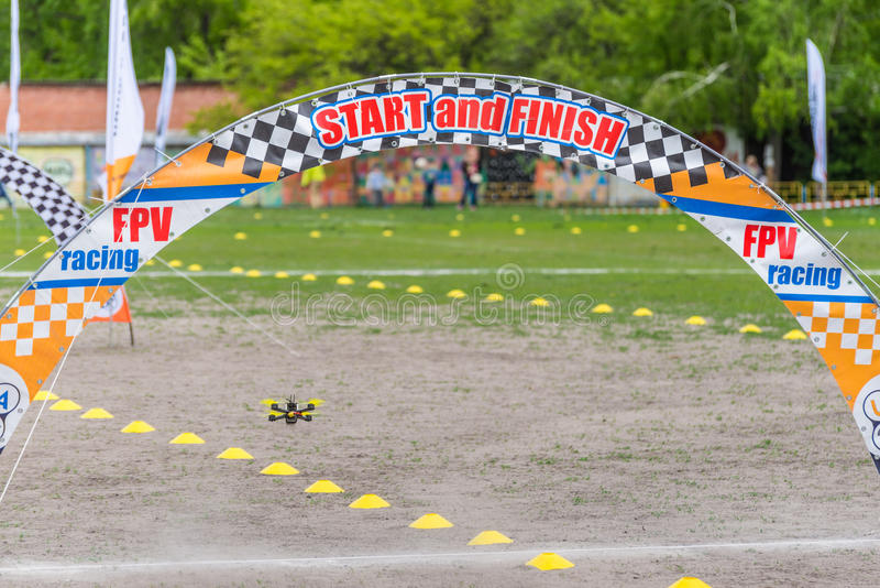 Drone Racing. Kyiv, Ukraine - April 29, 2017: Drone flies through the Racing gates during the first Drone Festival in Kyiv, Ukraine stock image
