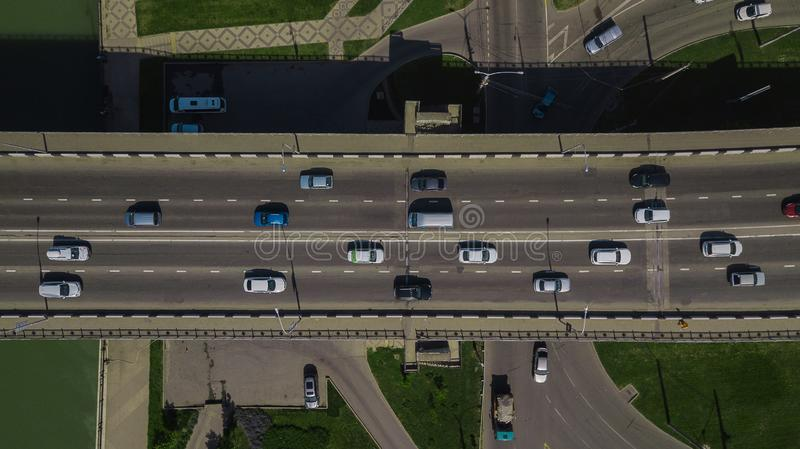 Drone's Eye View - Aerial top down view of urban traffic jam on bridge royalty free stock photography
