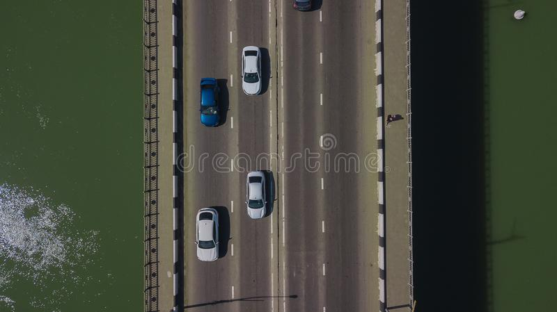 Drone\'s Eye View - Aerial top down view of urban traffic jam on bridge royalty free stock images