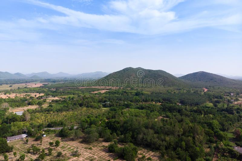 Drone shot aerial view scenic landscape of agriculture farm against mountain and nature forest. Above, agiculture, angel, asia, background, beautiful, birds royalty free stock images