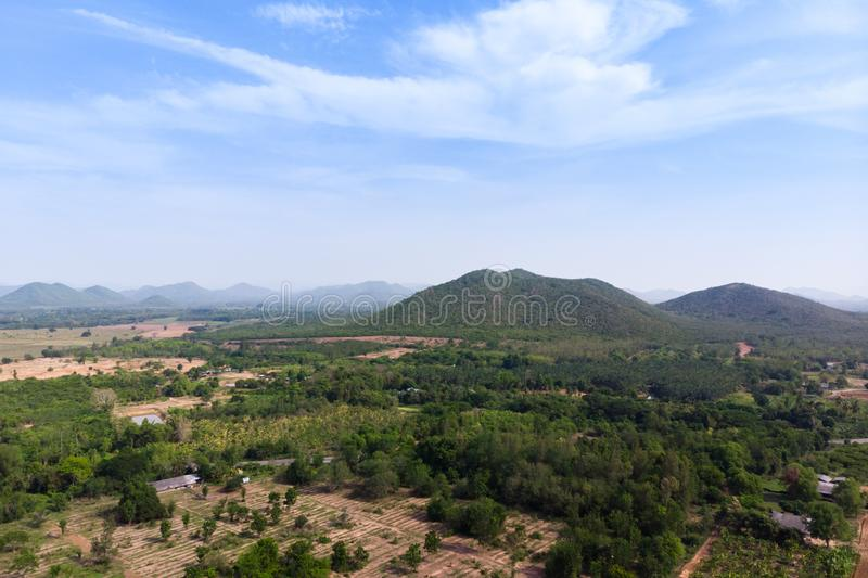 Drone shot aerial view scenic landscape of agriculture farm against mountain and nature forest. Above, agiculture, angel, asia, background, beautiful, birds stock photo