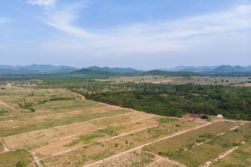 Drone shot aerial view scenic landscape of agriculture farm against mountain and nature forest. Above, agiculture, angel, asia, background, beautiful, birds stock image