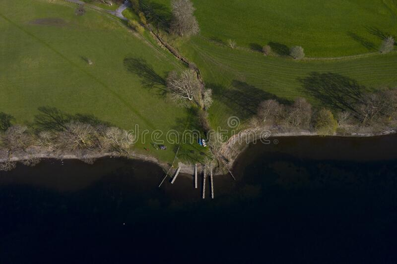 Drone shot Lake Coniston in the English Lake District. Drone shot of one of many small bays on lake coniston in the English Lake District stock photography