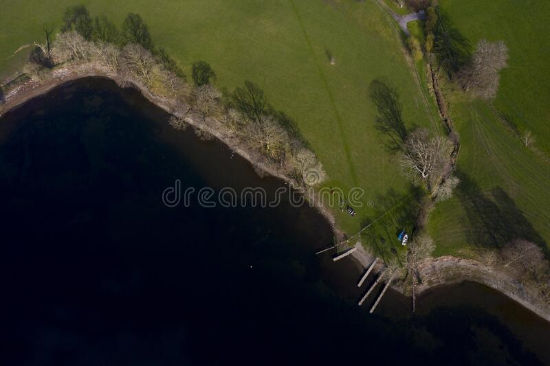 Drone shot Lake Coniston in the English Lake District. Drone shot of one of many small bays on Lake Coniston in the English Lake District royalty free stock photos