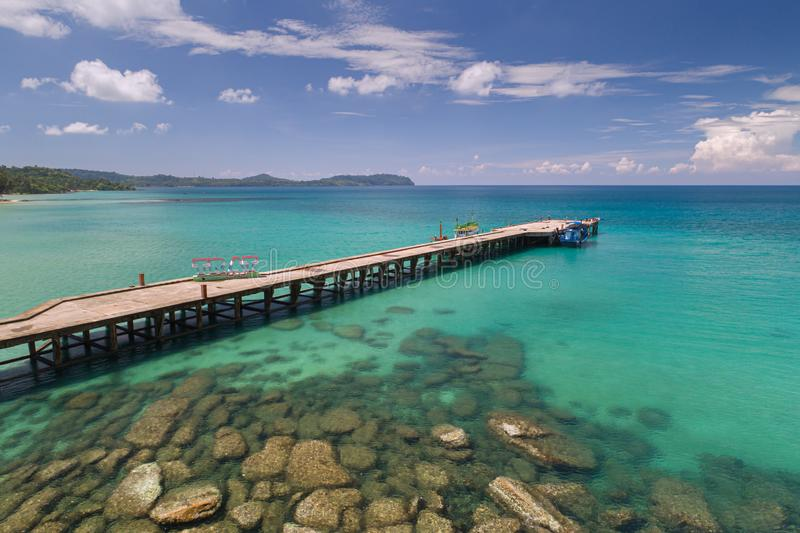 Drone shot of Wooden walkway bridge that lead to the sea and the beach in summer in Koh Mak Island at Trat stock image