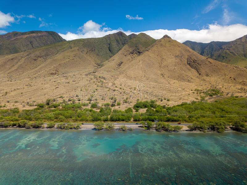 Drone side view of the dry mountains and crystal clear waters of the Lahaina Coast on the island of Maui, Hawaii royalty free stock image
