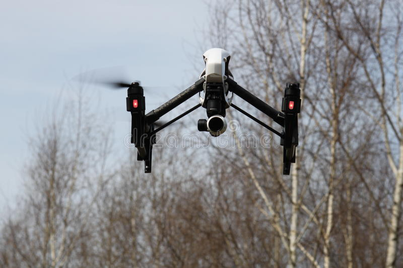 Drone in the Sky - DJI Inspire 1. Shot whith a 100mm 1:3,5 lens on a Canon 500D Blend 7.1, ISO 100, Shutter 1/500s royalty free stock photo