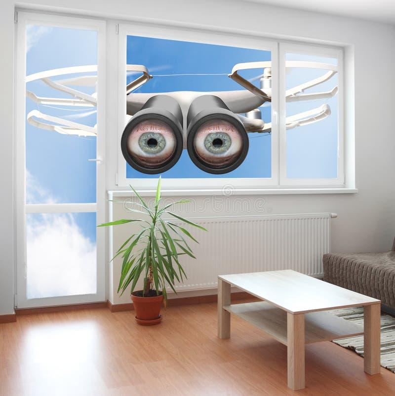 Drone spying through window. royalty free stock photo