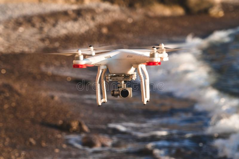 The drone in the sunset sky. ocean wave mountains Close up of quadrocopter outdoors. concept for film maker wedding videography stock image