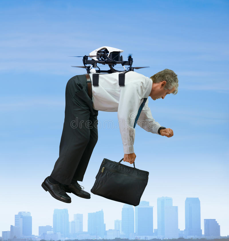 Drone taxi with businessman flying by city stock images