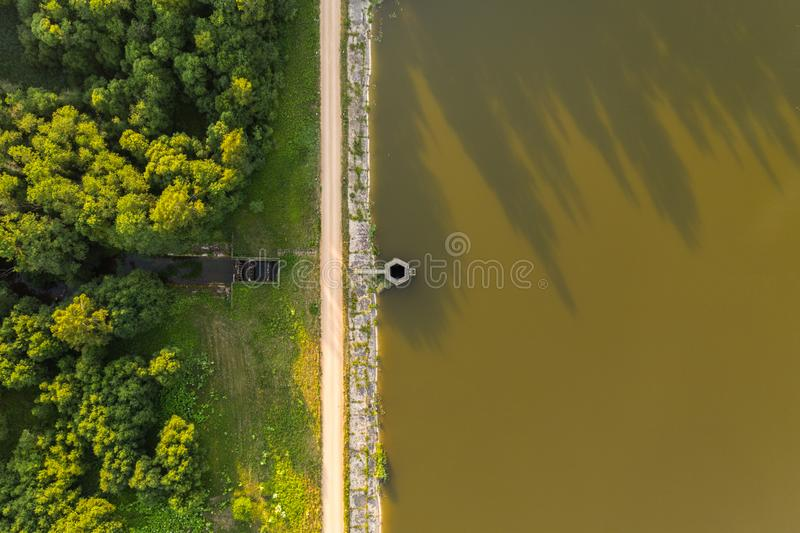 Drone top down view of lake reservoir and spillway stock images