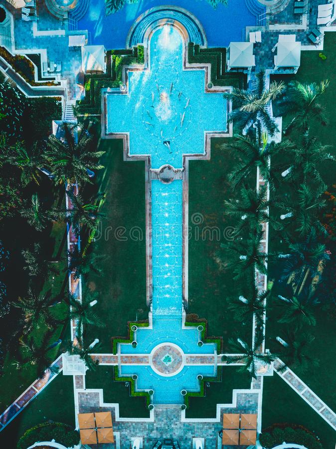 Drone top down view of water feature and multiple palm trees stock photo