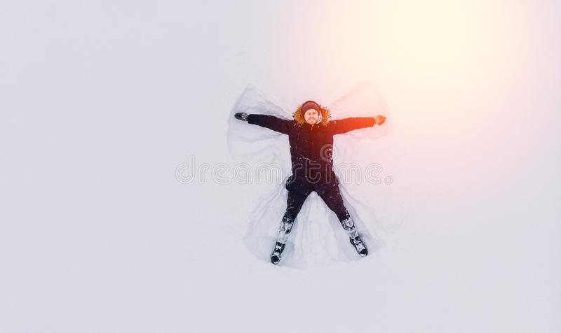 Top view snow angel man in december. Drone top view snow angel man in december royalty free stock photo