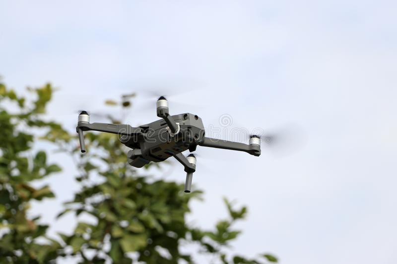 The Drone or Unmanned Aerial Vehicle UAV  flying in the sky stock image