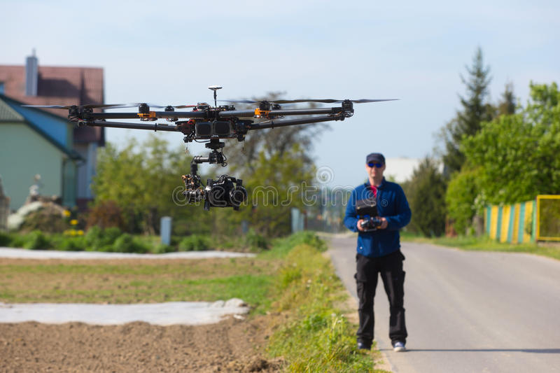 Drone, Unmanned copter flight, pilot flying drone. Drone preparation for flight. drone flight royalty free stock photos