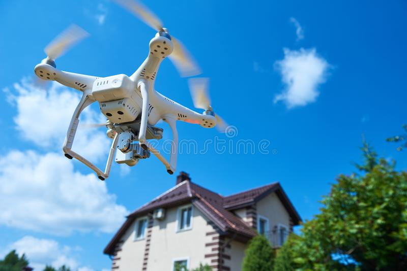 Drone usage. private property protection or real estate check. Drone usage in private property protection or real estate inspection royalty free stock photos