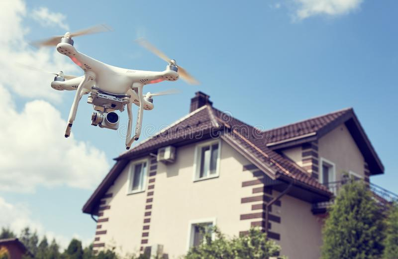 Drone usage. private property protection or real estate check. Drone usage in private property protection or real estate inspection stock photo