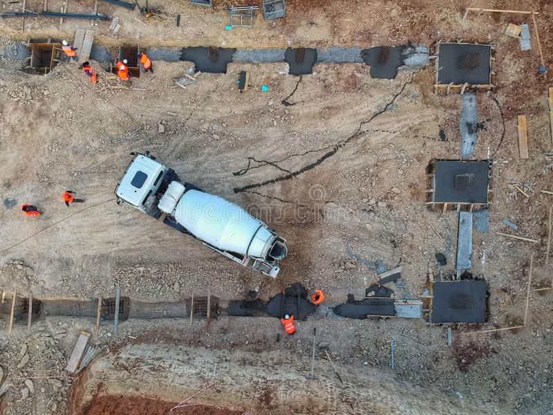 Drone view of a concrete truck and workers on a construction site stock photography