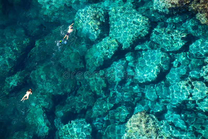 Drone view of a couple snorkeling in tropical sea stock images