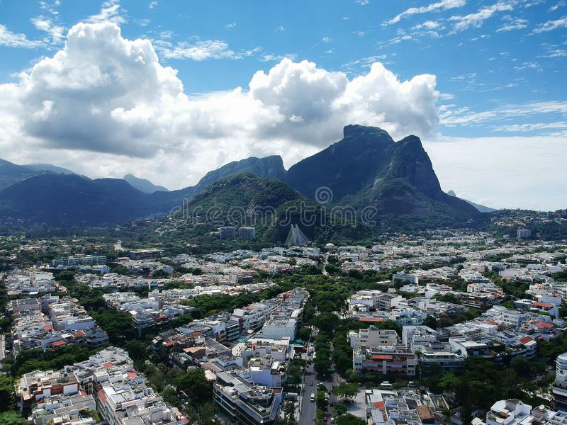 Drone view of Jardim Oceanico region in Barra da Tijuca,Gavea Stone hill, Rio de Janeiro. Drone photo of Barra da Tijuca boardwalk and Lucio Costa street, Rio de royalty free stock image