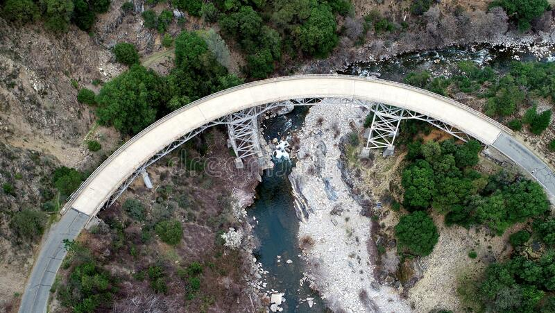 Drone view of a steel bridge crossing a wonderful river royalty free stock photos