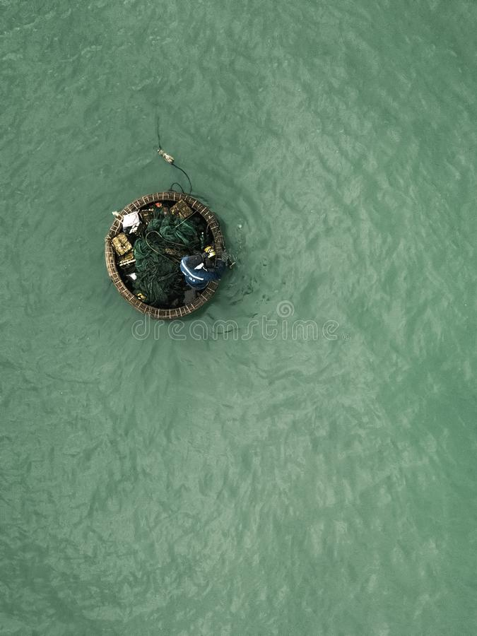 Drone view of Vietnamese fisher man stock photo