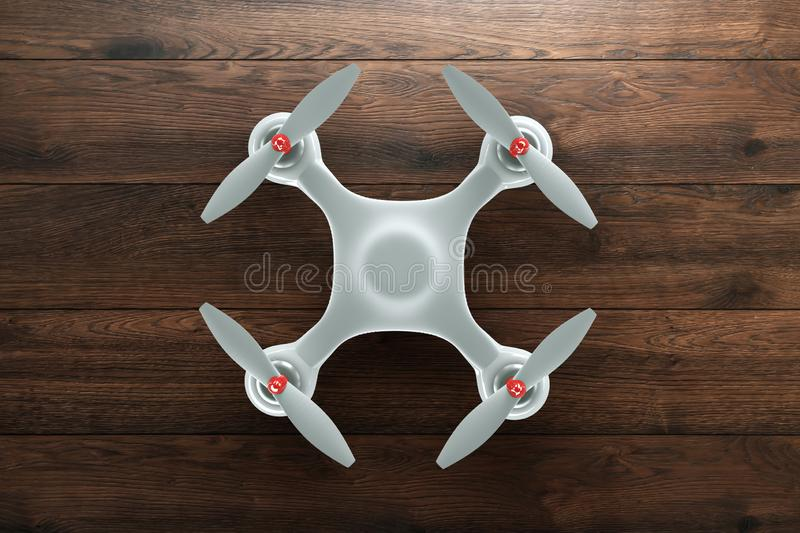 Drone, white quadrocopter on wooden, brown background with copy space. Top view, flat lay. The concept of technology, robotization. Computerization. 3D render vector illustration
