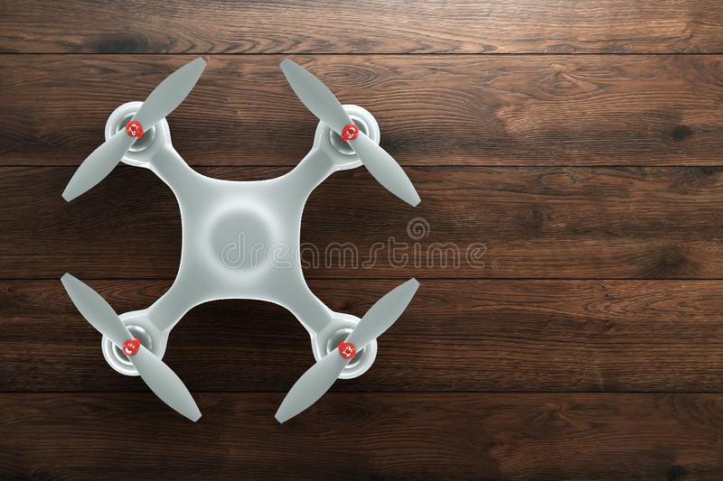 Drone, white quadrocopter on wooden, brown background with copy space. Top view, flat lay. The concept of technology, robotization. Computerization. 3D render royalty free illustration