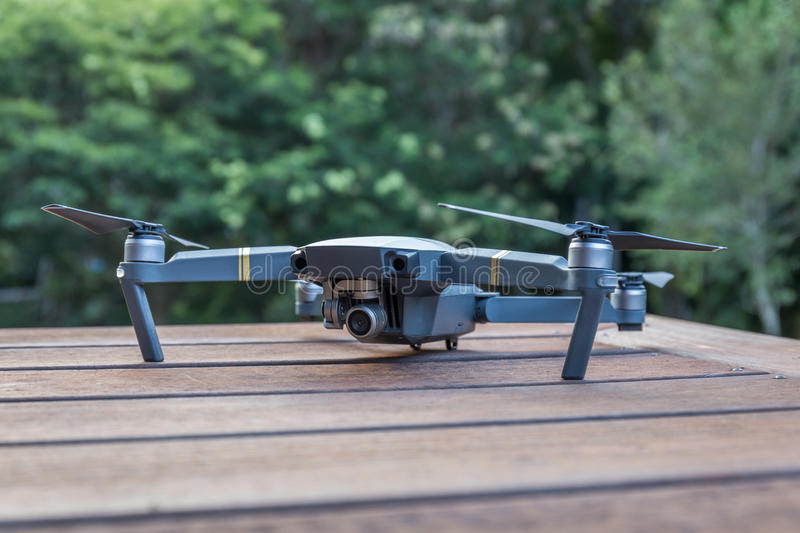 Drone on a wooden table royalty free stock photos