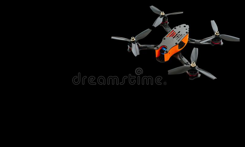 Drones racing FPV quadrocopter made from soot, drone ready for flight, stylish and modern hobby. on a black background banner or a. Dvertisement stock photos
