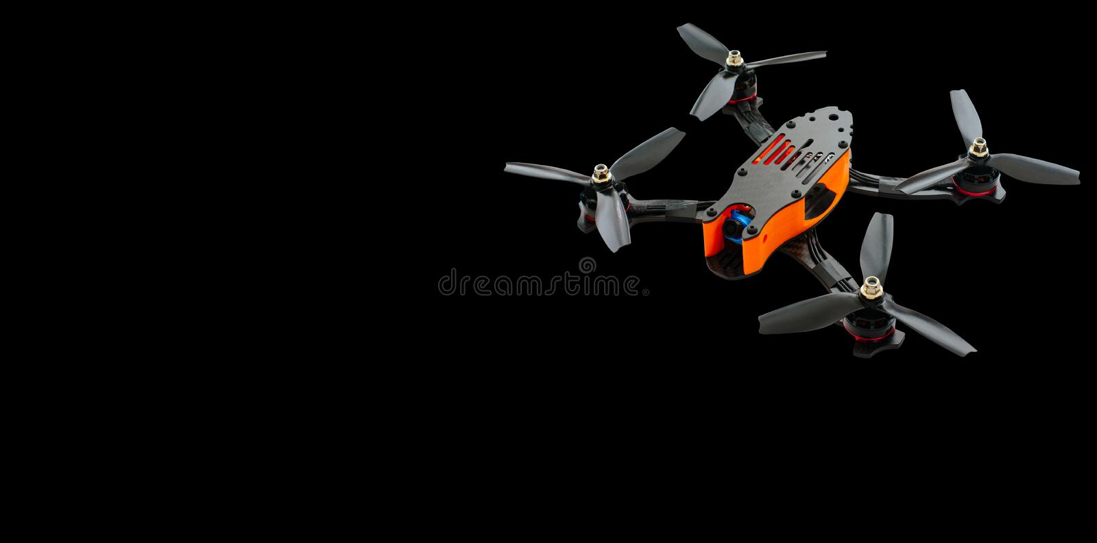 Drones racing FPV quadrocopter made from soot, drone ready for flight, stylish and modern hobby. on a black background banner or a. Dvertisement stock photo