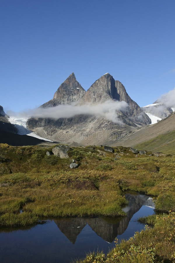 Dronning Marie Dal, Greenland. Mountains in Dronning Marie Dal, Greenland royalty free stock images