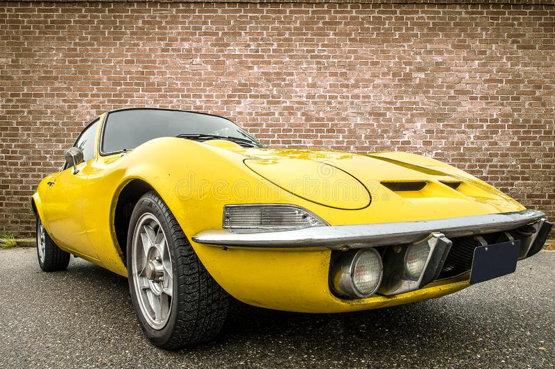 DRONTEN/NETHERLANDS-MAY 22, 2016: Low angle view of a yellow Opel GT. At a classic car meeting royalty free stock photo