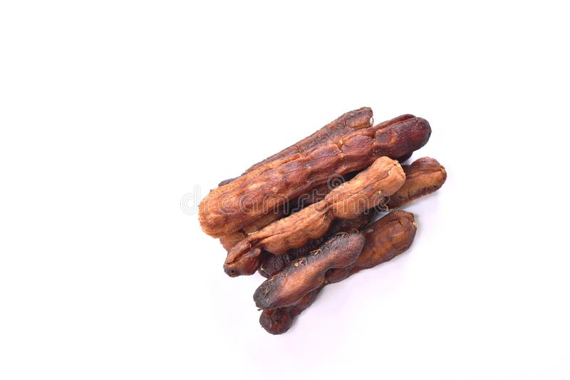 Droog de ingelegde zoete en zure Thaise conserve van de tamarindesmaak op witte achtergrond stock afbeelding