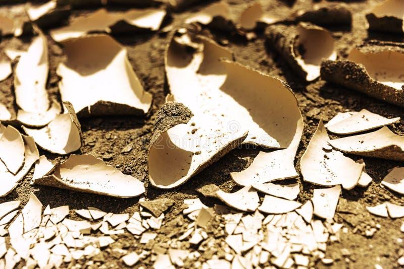 Droog gebarsten aarde Close-up droogte hitte Verwarmende Woestijn stock foto