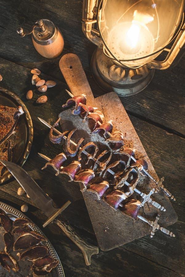Droog vlees op houten lijst royalty-vrije stock fotografie