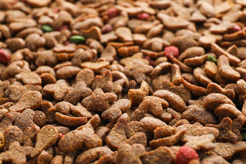 Droog voedsel voor huisdieren als achtergrond, stock afbeelding
