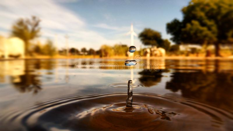 The drop. We can see the windmill inside the drop that make the click awsome stock image
