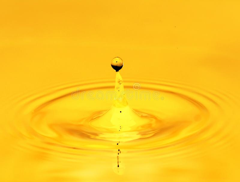 A drop of golden water. macro royalty free stock photo